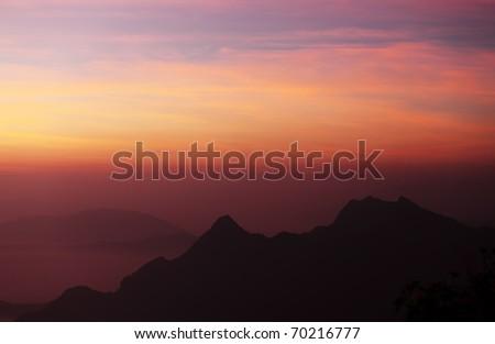 Mountain and Dawn Sky - stock photo