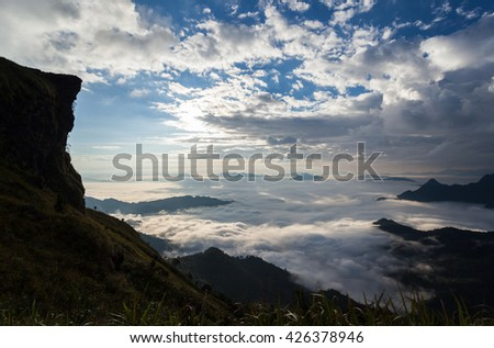 Mountain and mist sunrise in the morning  - stock photo
