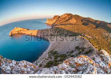 mountain and sea landscape through fish eye lens - stock photo