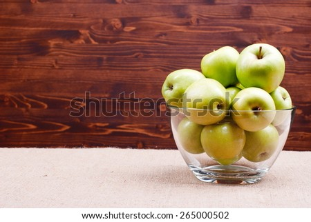 Mountain Apples in a glass bowl at the right edge, side view, place for text