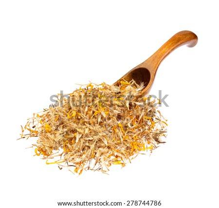 Mountain arnica on the wooden spoon. - stock photo