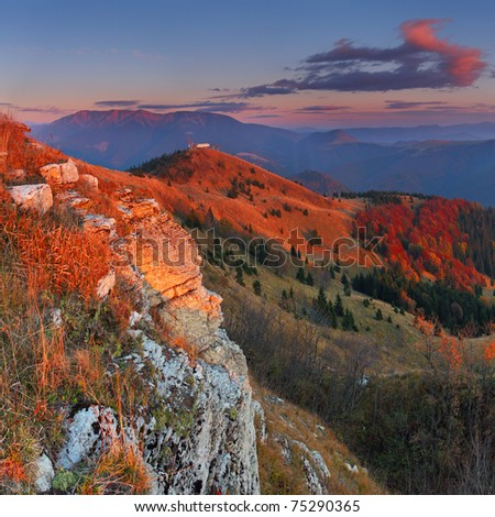 Mountain at sunset with rocks