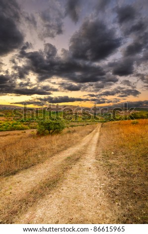 Mountain autumn landscape along which the road passes - stock photo