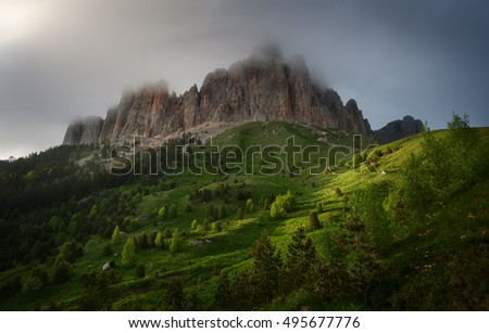Mountain Big Thach in spring greens and clouds. Caucasus, Russia