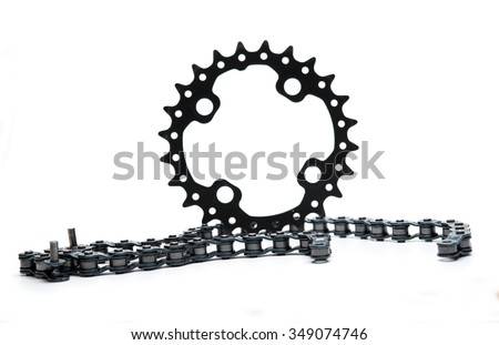Mountain bike chain ring with chain isolated on white - stock photo
