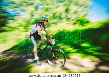 Mountain Bike cyclist riding track at sunny day, healthy lifestyle active athlete doing sport - stock photo