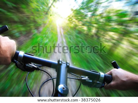 Mountain bike speed zoom motion blur. Fast downhill biking.