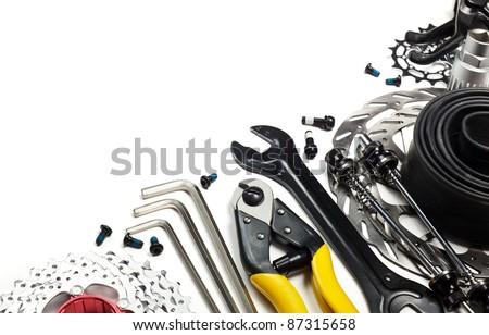 Mountain bike tools and spares on white background
