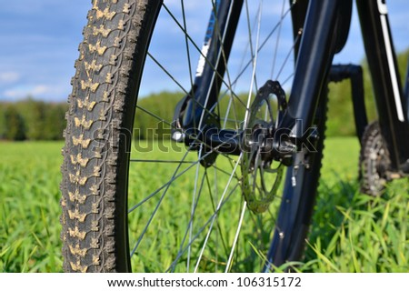Mountain bike wheel with disc brake. Shallow depth of field.