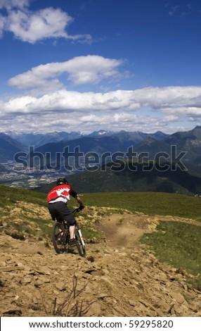 Mountain Biker at downhill - stock photo