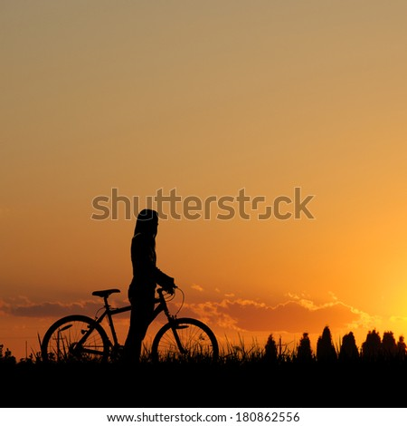 Mountain biker girl silhouette  - stock photo
