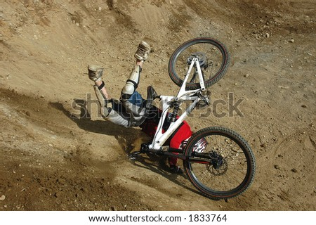 Mountain Biker takes a painful looking crash with his bike. - stock photo