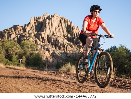 Mountain Biking on Beautiful Nature Trail - stock photo