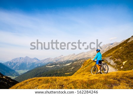 Mountain biking - woman on bike, Dolomites, Italy - stock photo