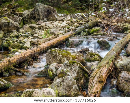 Mountain brook with mossy boulders in the Tatra mountans - stock photo