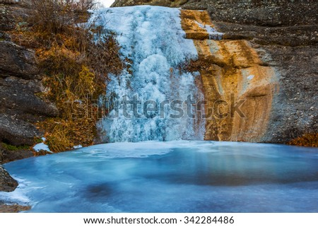 mountain canyon waterfall in a ice