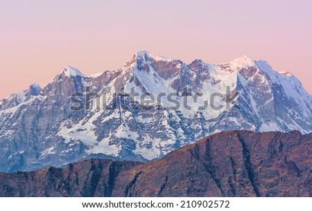 Mountain Chaukhambha during late sunset In Indian Himnalaya - stock photo