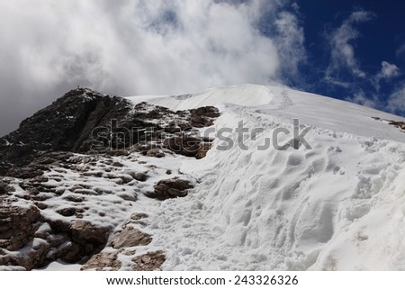 Mountain climbing in the snow on Marmolada, Dolomites - stock photo