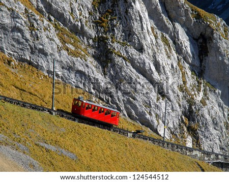 Mountain cogged railway leading to a peak of Mount Pilatus, Switzerland - stock photo