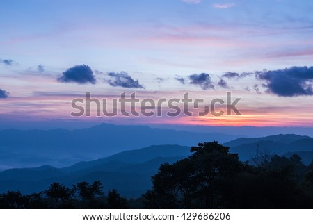 Mountain complex and colorful sky for background.
