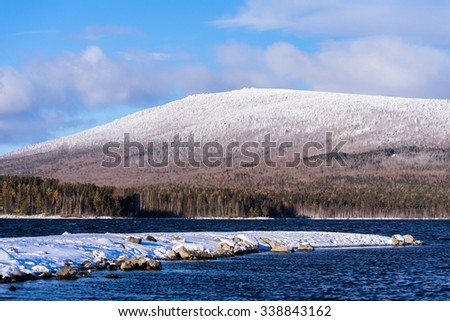 Mountain covered with snow and lake winter - stock photo