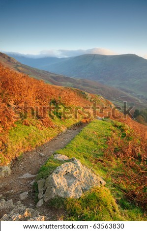 Mountain footpath in autumn near Windermere in the English Lake District - stock photo