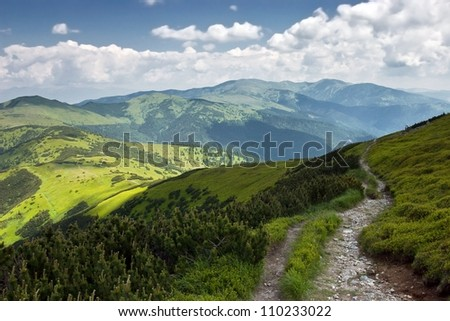 Mountain Footpath with Cloudy Skies in the Summer - National park Low Tatras - Slovakia/Europe - stock photo