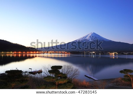 Mountain Fuji and reflections on lake Kawaguchi at dawn - stock photo