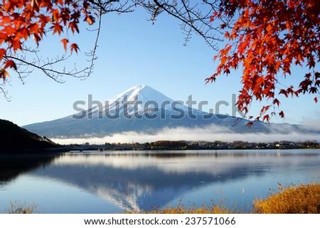Mountain Fuji Kawaguchiko lake Japan with red maple leaf - stock photo