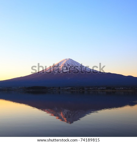 Mountain Fuji with reflection on the lake at early morning, Japan - stock photo