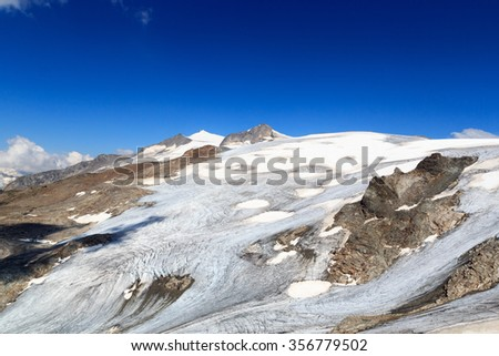 Mountain glacier panorama with summit Grossvenediger south face in the Hohe Tauern Alps, Austria - stock photo