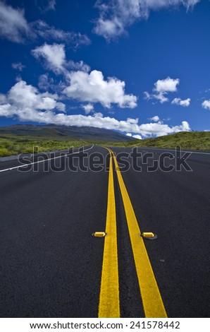 Mountain highway heading uphill - stock photo