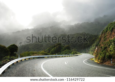 Mountain highway in a morning mist - stock photo