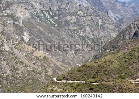 Mountain highway in rugged Kings Canyon National Park, Western Sierra, California - stock photo