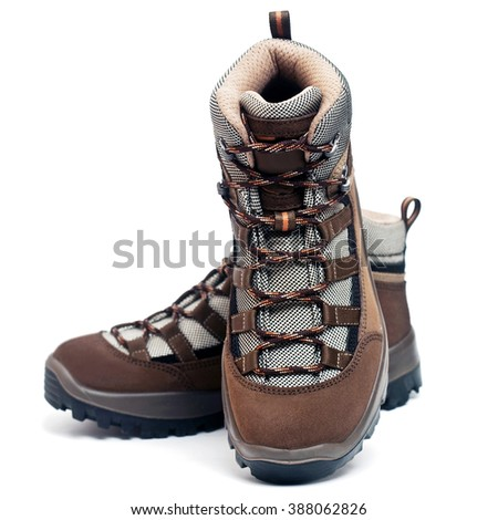 Mountain hiking boots isolated on the white background - stock photo