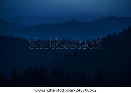 Mountain Hills Silhouettes. Summer Evening in the Sierra Nevada Mountains.