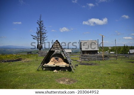 Mountain household in Transylvania/Mountain house with bread oven/Mountain landscape with house in Transylvania - stock photo