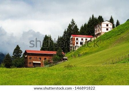 Mountain houses with clouds in Ayder Plateau, Rize, Turkey.
