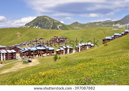 Mountain La Plagne village in the french Alps,commune in the Tarentaise Valley, Savoie department and Rhone-Alpes region in France - stock photo