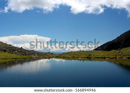 Mountain lake at Sayan Mountains - stock photo