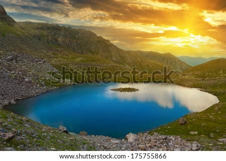 mountain lake at the sunset - stock photo
