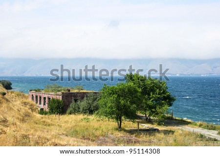Mountain lake Sevan in Armenia, foggy day.
