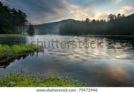 Mountain Lake Sunrise near Cashiers, North Carolina - stock photo