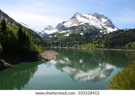 Mountain lake, Switzerland - stock photo