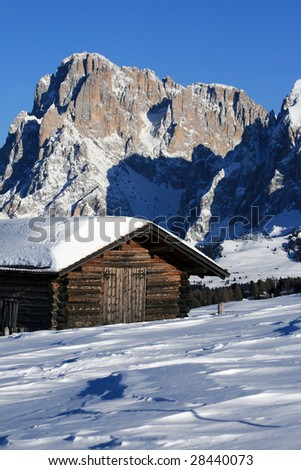 mountain landscape, chalet in the snow, alps - stock photo