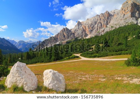 Mountain landscape covered with green vegetation, Dolomite Alps, Italy - stock photo