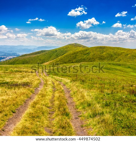 mountain landscape. curve path through the meadow on hillside - stock photo