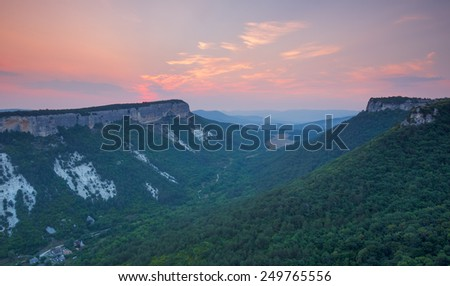 Mountain landscape in the early morning at sunrise. Mountain Crimea, view from the plateau Mangup - stock photo