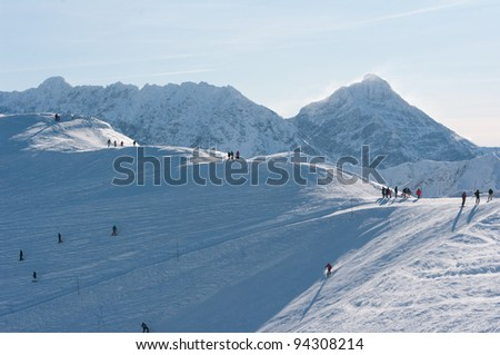Mountain landscape in the winter and the skiers