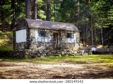 Mountain landscape. Old stone cottage in summer woods. - stock photo